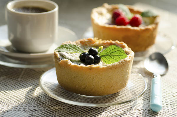 Mini berry tarts with a cup of coffee