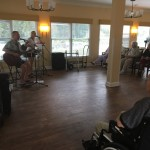 Residents enjoying concert.