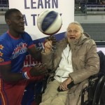 100 year old resident learns to spin the ball on her finger.