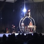 Performer of Cirque Esprit on a rolling wheel.