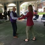 Resident and Community Life Assistant, Jeannie Harrington, dancing.