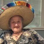 Resident showing off her sombrero.